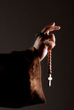 Preaching medieval monk. Hand with wooden rosary Stock Images
