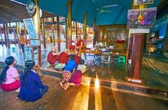 The preaching in Nga Phe Chaung Monastery, Inle Lake, Myanmar. YWAMA, MYANMAR - FEBRUARY 18, 2018: The preaching in Nga Phe Chaung Monastery of jumping cats Royalty Free Stock Image