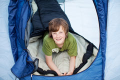 Preadolescent Boy Lying In Tent Royalty Free Stock Photography