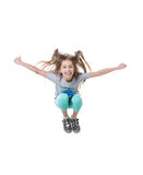 Preadolescente que salta para arriba, aislado en el fondo blanco Fotografía de archivo