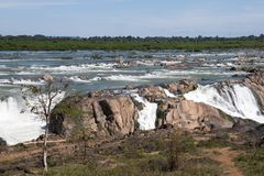 Preah Nimith waterfall and rapids on the Mekong river in dry season. Preah Rumkel near the Lao border, Cambodia Royalty Free Stock Photography