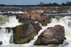 Preah Nimith waterfall and rapids on the Mekong river on the in dry season. Preah Rumkel near the Lao border, Cambodia Royalty Free Stock Photo