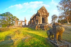 Preah Vihear Temple. The Preah Vihear Temple is located slightly east of the midsection of the mountain range of Dangrèk. It is also perched on the edge of a Stock Image