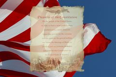 Preamble of the Constitution. Photo of the preamble to the constitution with a flag background Stock Photo