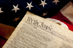 Preample of the constitution and american flag Stock Photos
