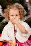 Preaty little girl eating tangerine Royalty Free Stock Photography