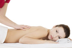 Preaty woman relaxing beeing massaged in spa Stock Images
