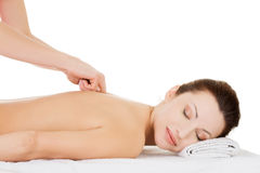 Preaty woman relaxing being massaged in spa saloon. Stock Photo