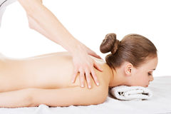 Preaty young woman relaxing beeing massaged in spa saloon Stock Photography