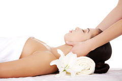Preaty young woman relaxing heaving massage therapy Royalty Free Stock Image