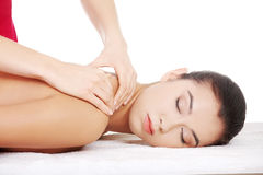 Preaty young woman relaxing heaving massage therapy Royalty Free Stock Images