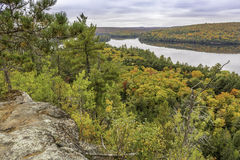Precambrian Rock with Fall Colors and a Lake in the Background -. Lookout from a rocky outcrop over a lake surrounded by fall forest - Algonquin Provincial Park royalty free stock photography