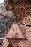 Precarious Plank Bridge On Cliff Stock Photo