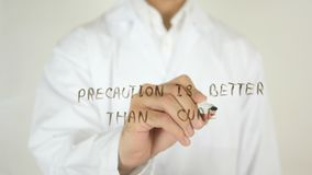 Precaution is Better than Cure, Written on Glass. High quality Royalty Free Stock Photography