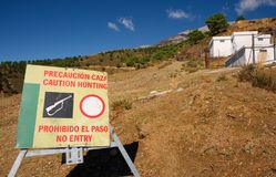 Warning sign, hunting in the Spanish hills. Stock Image