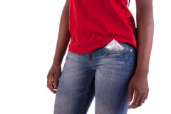 Precautionary. A young woman with a condom in her trouser pocket Stock Images