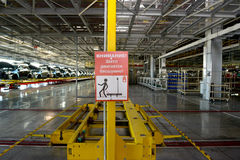 Precautionary inscription. Attention! Shatl moves silently! in assembly shop of automobile plant Stock Photos