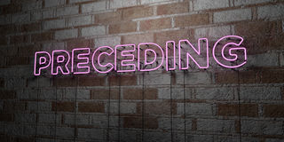 PRECEDING - Glowing Neon Sign on stonework wall - 3D rendered royalty free stock illustration Royalty Free Stock Images