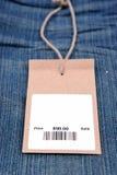 Precio con el código de barras en vaqueros Imagen de archivo libre de regalías