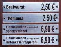 Precios con los precios para la comida Imagenes de archivo