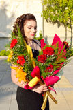 Precioso con las flores Foto de archivo
