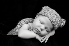 Precious baby. Beautiful newborn baby boy in adorable hat with ears Stock Photo