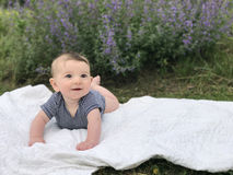 Baby boy laying on white stock photo