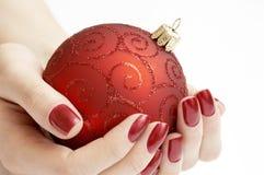 Precious Christmas globe. Woman holding precious Christmas globe Stock Images