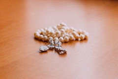 Precious cute pearl beads on wooden rustic background Royalty Free Stock Photo
