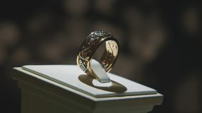 Precious diamond rings. Fine luxury diamond jewellery window display with ring pedant. Gold ring with brilliant isolated Royalty Free Stock Images