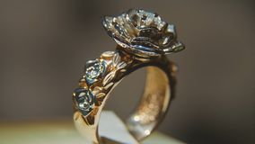 Precious diamond rings. Fine luxury diamond jewellery window display with ring pedant. Gold ring with brilliant isolated Stock Photos