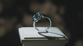Precious diamond rings. Fine luxury diamond jewellery window display with ring pedant. Gold ring with brilliant isolated Royalty Free Stock Image