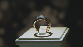 Precious diamond rings. Fine luxury diamond jewellery window display with ring pedant. Gold ring with brilliant isolated Royalty Free Stock Photography