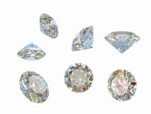 Precious Diamonds. A background of 7 diamonds of different shapes, isolated on a white background Royalty Free Stock Photos