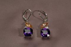 Precious earrings with stones Stock Photo