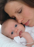 Precious Gift. A mother caresses her newborn baby girl Stock Images