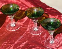 Precious Green vintage glasses for sale in the antique shop Royalty Free Stock Photos