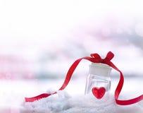 Precious heart. In a glass jar Stock Photos