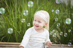 Precious Little Girl Having Fun With Bubbles Royalty Free Stock Photography