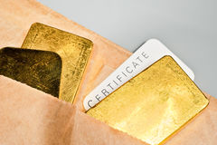 Precious metals trading. Processing and global trading of precious metals. Gold bars, certificate and paper pack. Closeup Stock Photography