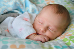 Precious Newborn Baby Girl Sleeping Stock Image