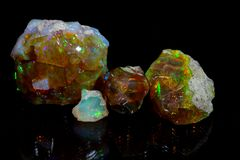 Precious opal. On a mirror and a black background royalty free stock image