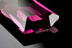 Precious purple diamond. On a black background with a copy space Royalty Free Stock Photos