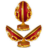 Precious red egg with gold pattern and rubies Royalty Free Stock Photography