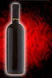 Precious Red Wine. Bottle of precious red wine on a textured background Royalty Free Stock Photography