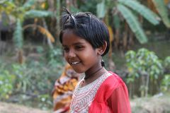 Moods,happiness,innocence,tribal,cute,girl,smile,portrait. A precious smile of a cute tribal giral Stock Photos