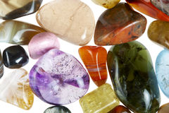 Precious stones. Collection of beautiful precious stones against white background stock image