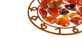 Precious stones. Dial of hours with precious stones against white background royalty free stock photo