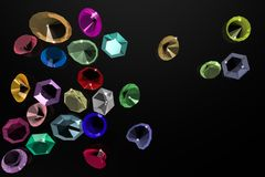 Precious stones on a black background. Stock Photos
