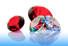 The precious stones emeralds,rubies and diamonds Stock Photos